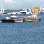 The Mosquito Fleet's protest barge, currently moored off of Alki.